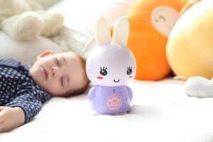Purple Alilo Honey Bunny with sleeping little kid