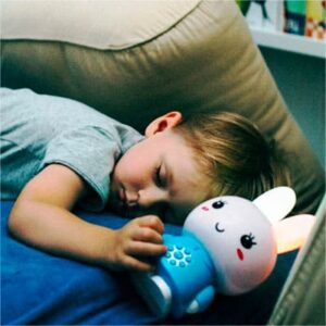 Boy Sleeping with Alilo Honey Bunny Nightlight